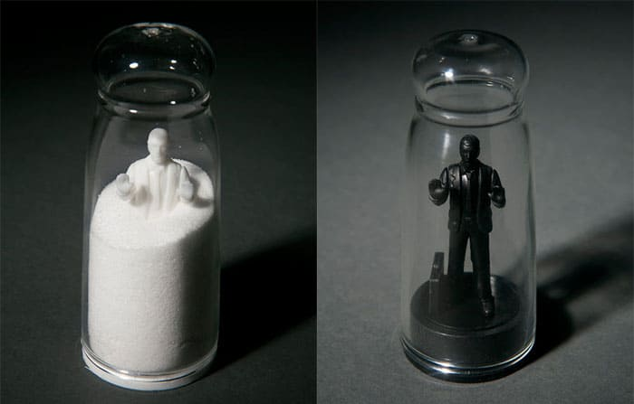 Kikkerland Drowning In Debt Salt And Pepper Shakers