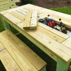 Keep your cans hidden and cold in a picnic table.