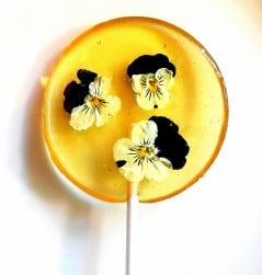 Liquor in the form of a flowery lollipop.