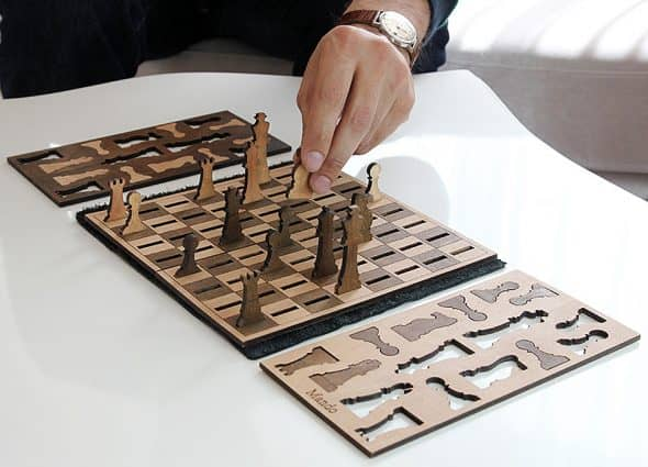 Play a simple game of chess, using a simple chess set.