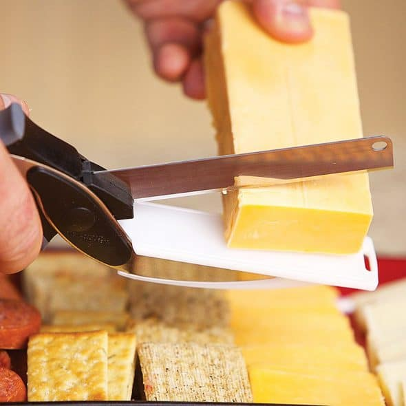 Chop food in seconds with a 2-in-1 Knife and Cutting Board Tool.