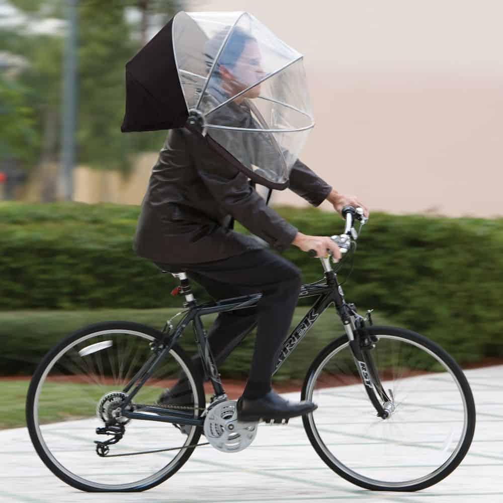 Nubrella Hands Free Umbrella Guy in a Bike