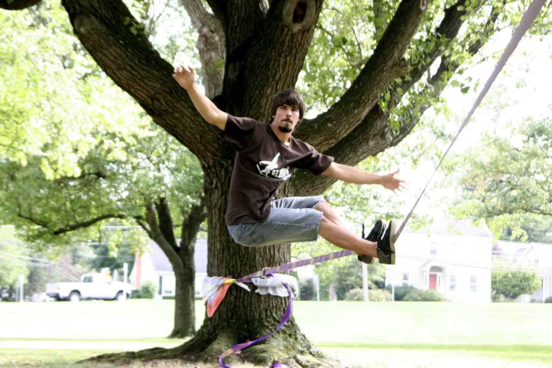 Gibbon Slackline Surfline Tied on a Tree in a Park