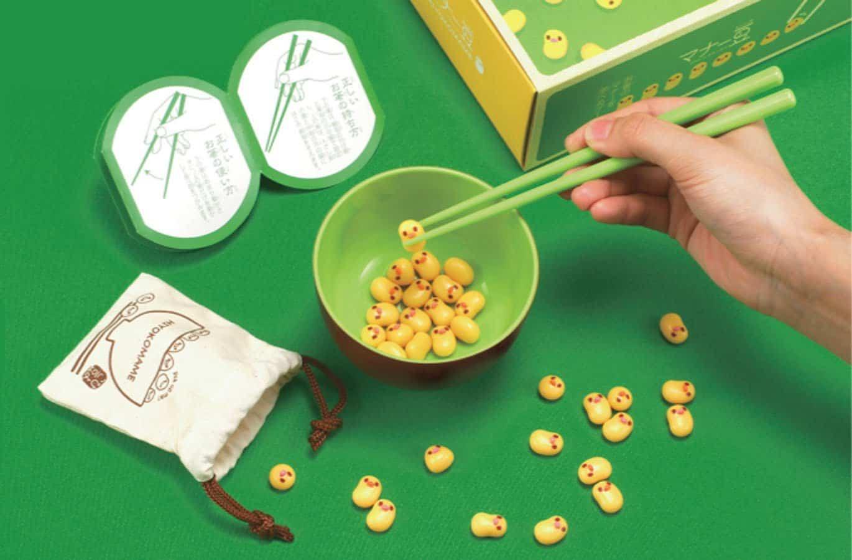 Attain mad chopstick skills with little chicken beans!