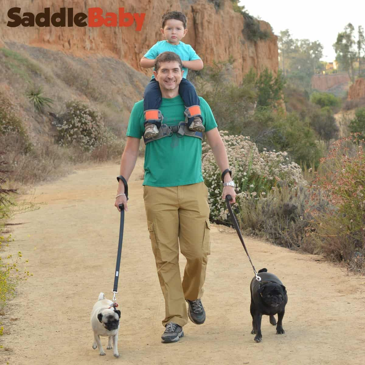 SaddleBaby Shoulder Carrier Hiking Man With Kid and Dogs