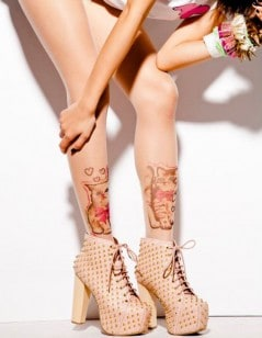 Wearable cat tattoos on your legs.