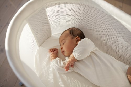 BabyBjorn Cradle Baby on a Crib