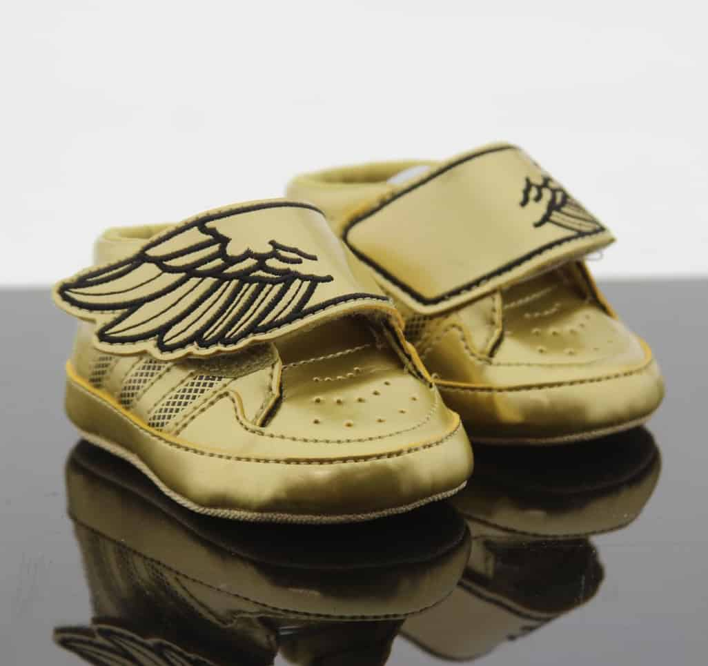 Golden shoes for the newborn.