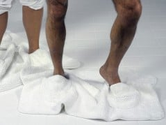 Dry your feet and wipe the bathroom floor at the same time.