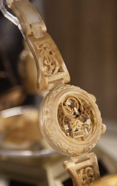 Wooden time piece with an exotic vintage style.