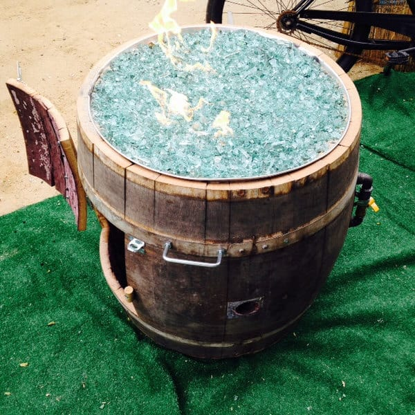 Warm up those cold lonely nights with a barrel of fire. - Smokin Barrel Works Whiskey Barrel Fire Pit - NoveltyStreet