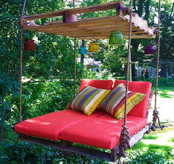 Hang a couple of pallets for a more romantic backyard.