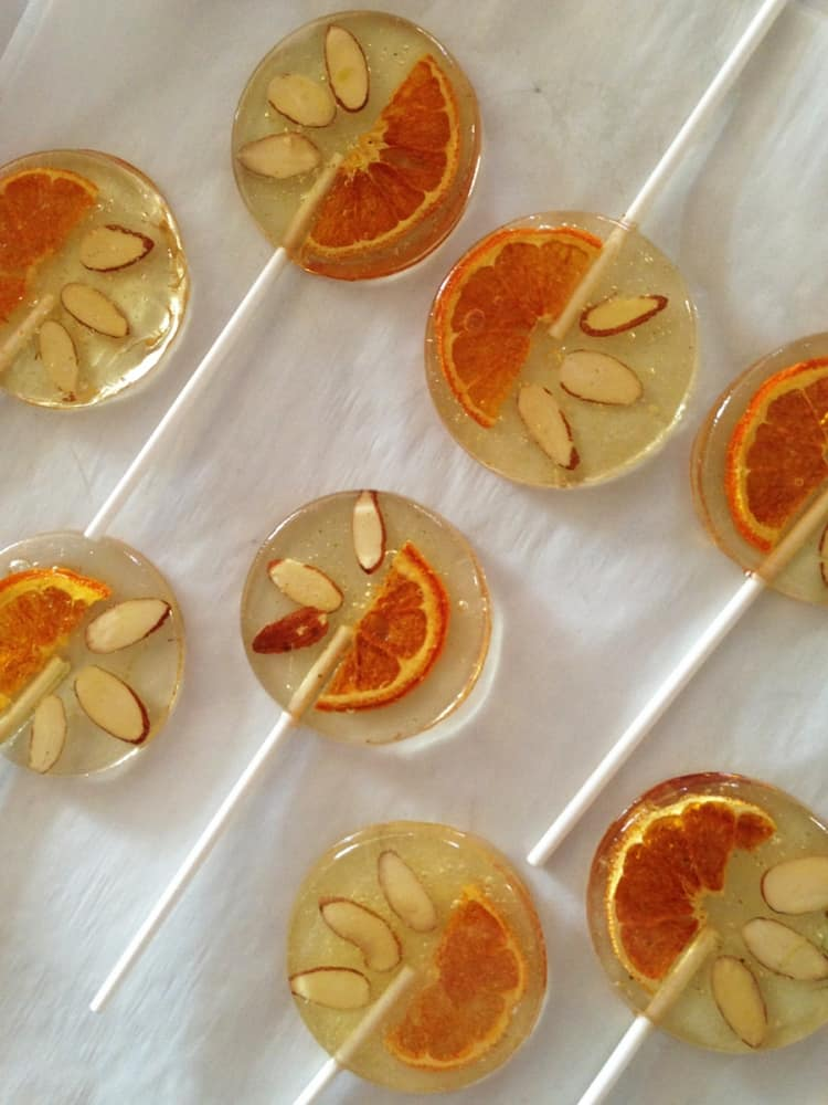A Secret Forest Italian Bergamot Lollipops With Tangerine Slices & Slivered Almonds Cool Candies