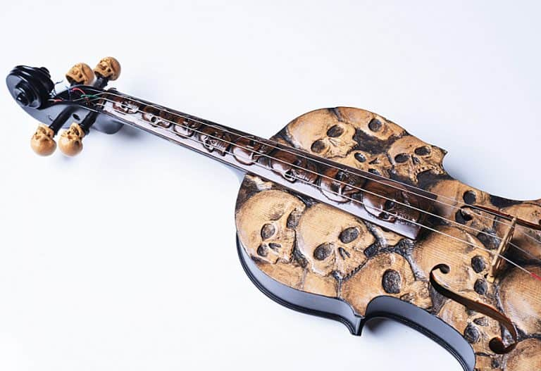 Artist In Fla Carved Skull Violin Decoration