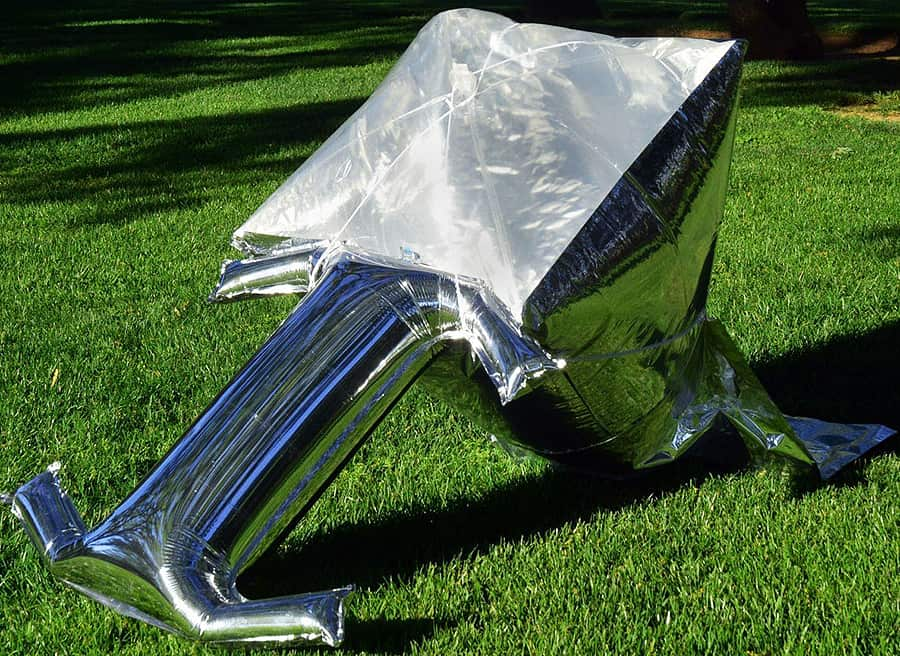 Unfold, inflate then let the sun cook your food for you.