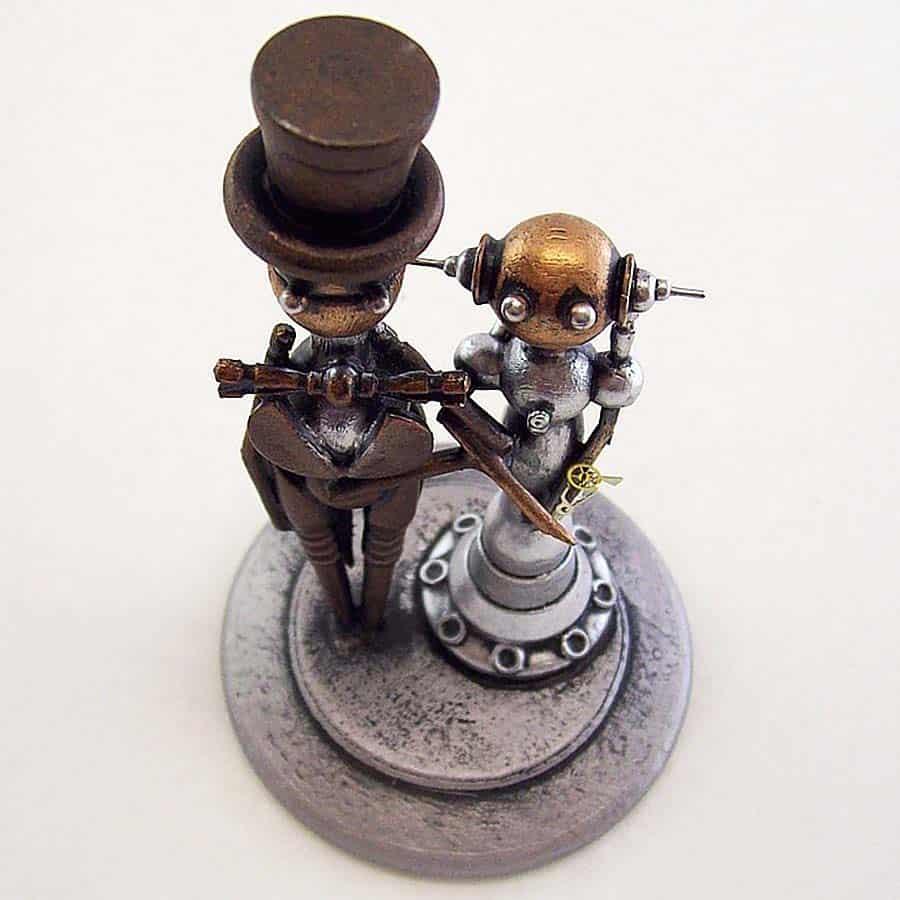 builders-studio-elegant-robot-couple-wedding-cake-topper-centerpiece