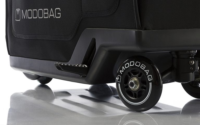 modobag-motorized-rideable-luggage-quick-release-foot-peg