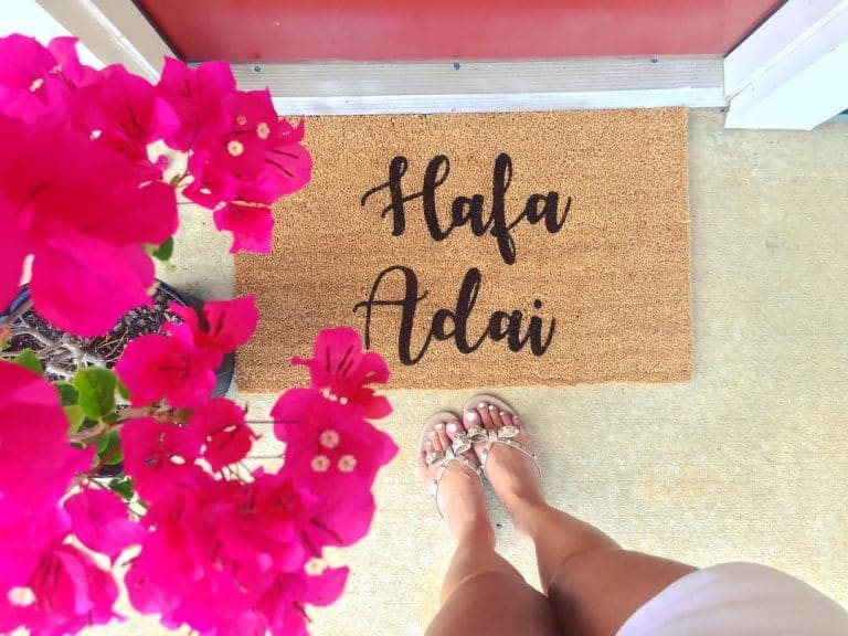 Brown coir door mat with text Hafa Adai