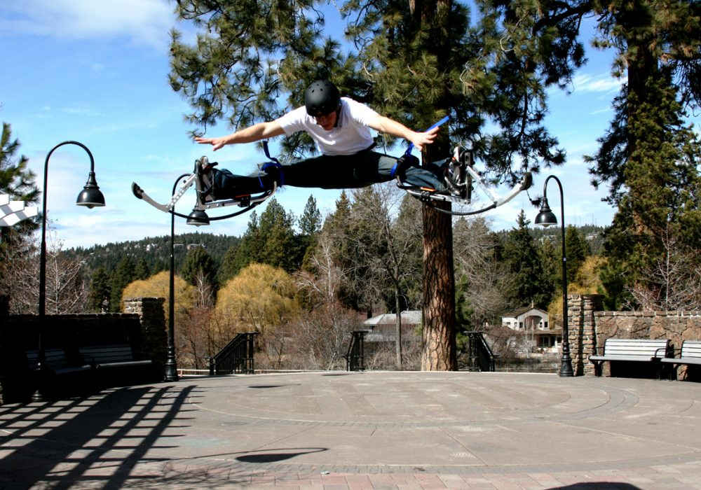 Air Trekker Jumping Stilts Fun Outdoor Activity Boy Doing Mid Air Split