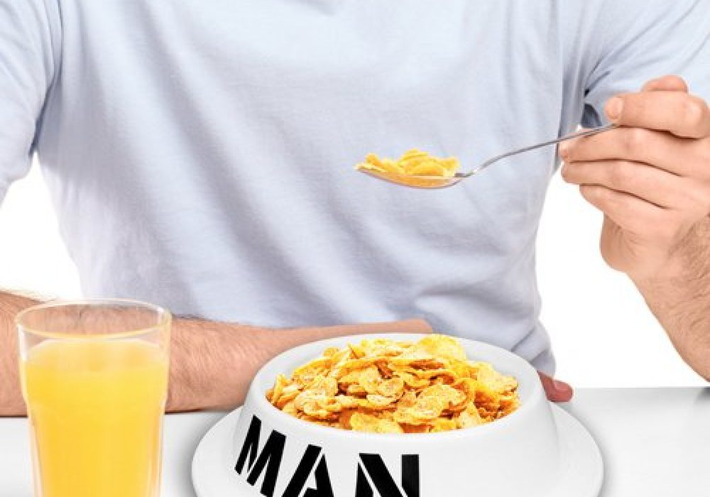 Thumbs Up! Man Bowl Cornflakes Cereal and Orange Juice